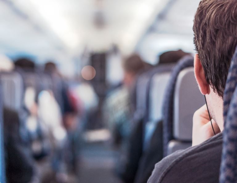 earbuds on plane